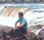 Sammy Bond sitting by Aponguao Waterfall